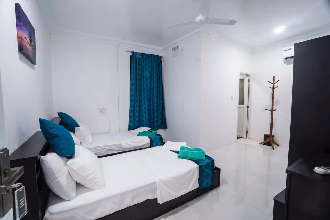 Budget maldives surf Thulusdhoo island surf camp palm lodge 3