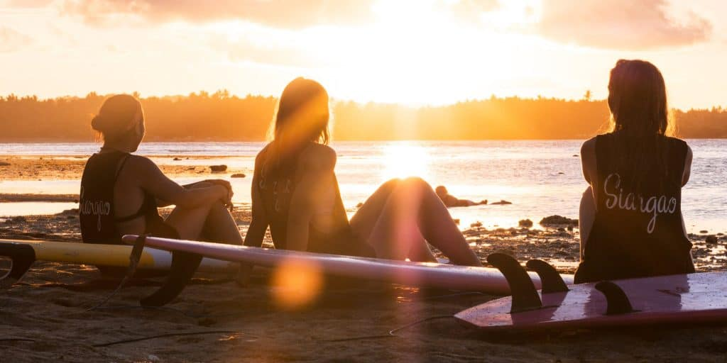 learn to surf siargao surf camp philippines mad monkey hostel